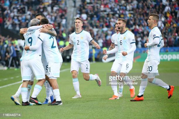 Sergio Aguero of Argentina celebrates with teammates after scoring the opening goal during the Copa America Brazil 2019 Third Place match between...