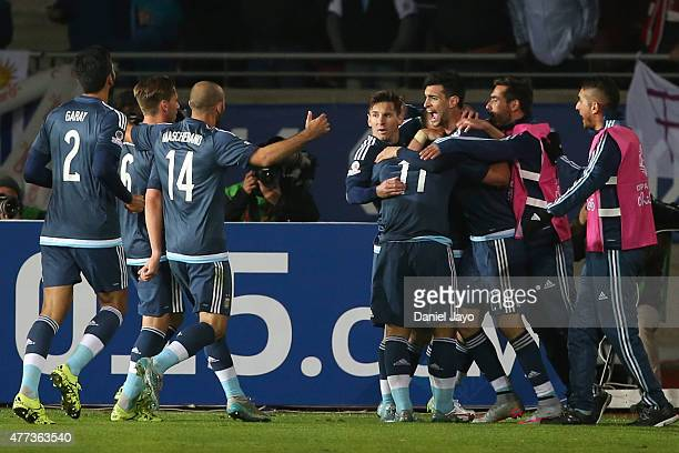 Sergio Aguero of Argentina celebrates with teammates after scoring the opening goal during the 2015 Copa America Chile Group B match between...