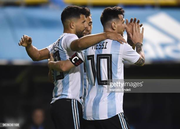 Sergio Aguero of Argentina celebrates with teammates after scoring the fourth goal of his team during an international friendly match between...