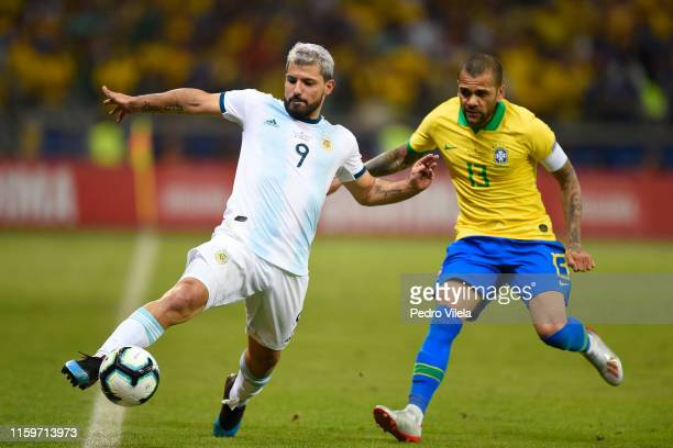 Sergio Aguero of Argentina controls the ball against Dani Alves of Brazil during the Copa America Brazil 2019 Semi Final match between Brazil and...