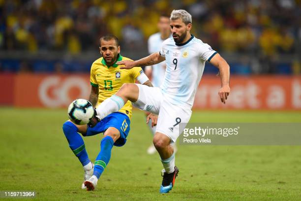 Sergio Aguero of Argentina controls the ball with Dani Alves of Brazil during the Copa America Brazil 2019 Semi Final match between Brazil and...
