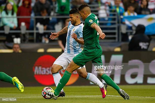 Sergio Aguero of Argentina dribbles against Nelson Cabrera of Bolivia during the 2016 Copa America Centenario Group D match at CenturyLink Field on...