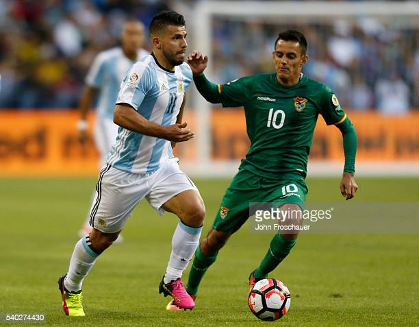 Sergio Aguero of Argentina dribbles past Jhasmani Campos of Bolivia during a group D match between Argentina and Bolivia at Century Link Field as...
