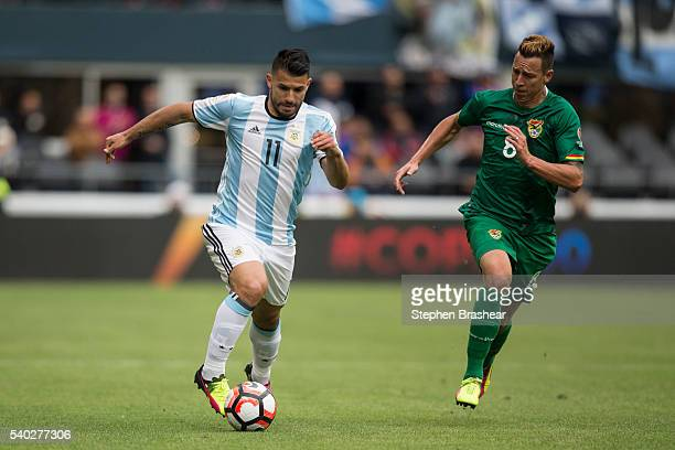 Sergio Aguero of Argentina dribbles the ball upfield against Martin SmedbergDalence of Bolivia during a group D match between Argentina and Bolivia...