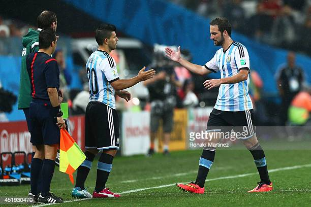 Sergio Aguero of Argentina enters the game for Gonzalo Higuain during the 2014 FIFA World Cup Brazil Semi Final match between the Netherlands and...