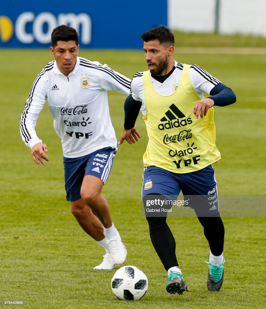 Sergio Aguero of Argentina fights for the ball with Enzo Perez of Argentina during an open to public training session at Bronnitsy Training Camp on June 11, 2018 in Bronnitsy, Russia.