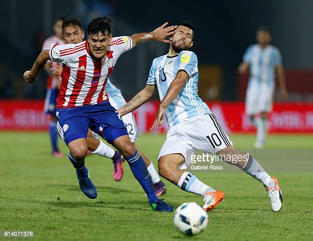 Sergio Aguero of Argentina fights for the ball with Gustavo Gomez of Paraguay during a match between Argentina and Paraguay as part of FIFA 2018...
