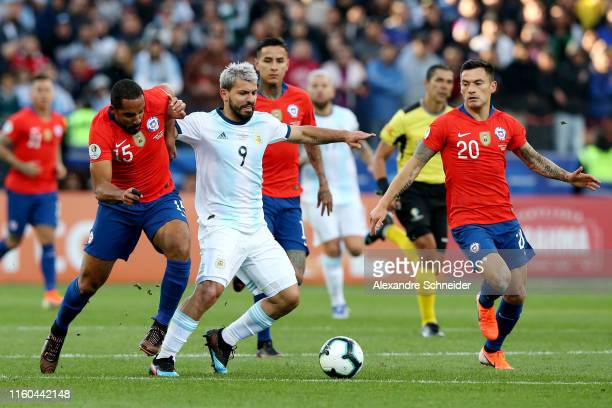 Sergio Aguero of Argentina fights for the ball with Jean Beausejour of Chile during the Copa America Brazil 2019 Third Place match between Argentina...