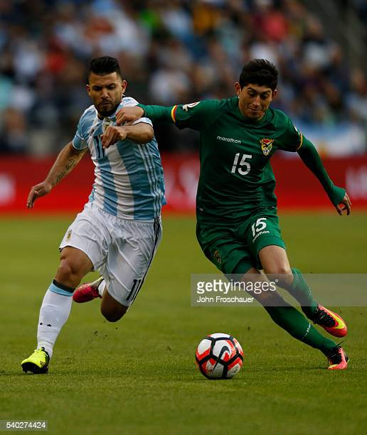 Sergio Aguero of Argentina fights for the ball with Pedro Azogue of Bolivia during a group D match between Argentina and Bolivia at Century Link...