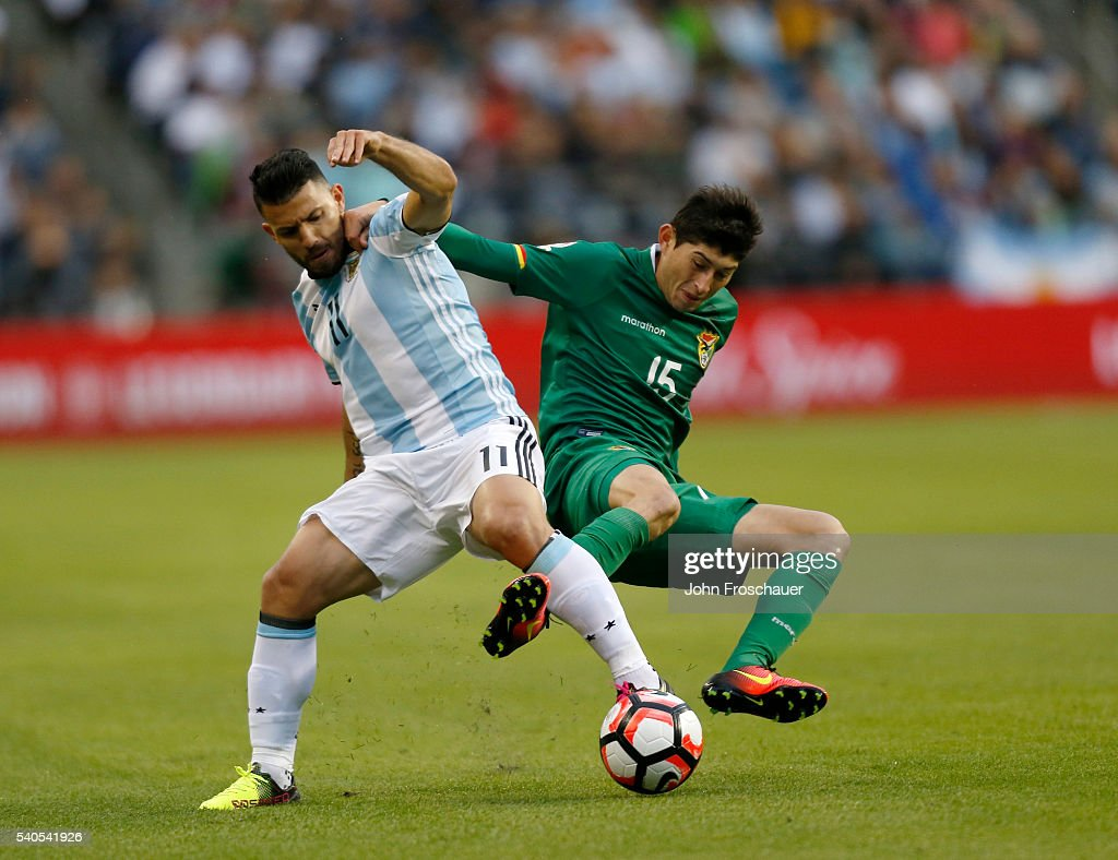 Sergio Aguero of Argentina fights for the ball with Pedro Azogue of Bolivia during a group D match between Argentina and Bolivia at Century Link Field as part of Copa America Centenario US 2016 on June 14, 2016 in Seattle, Washington, US.