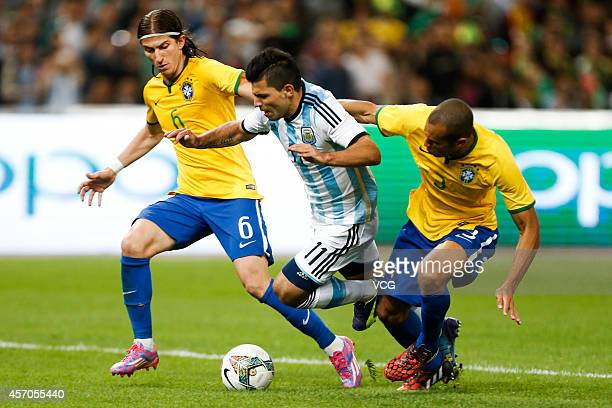 Sergio Aguero of Argentina is challenged by Brazil players during a match between Argentina and Brazil as part of 2014 Super Clasico at Beijing...