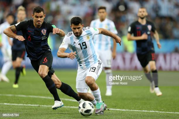 Sergio Aguero of Argentina is challenged by Dejan Lovren of Croatia during the 2018 FIFA World Cup Russia group D match between Argentina and Croatia...
