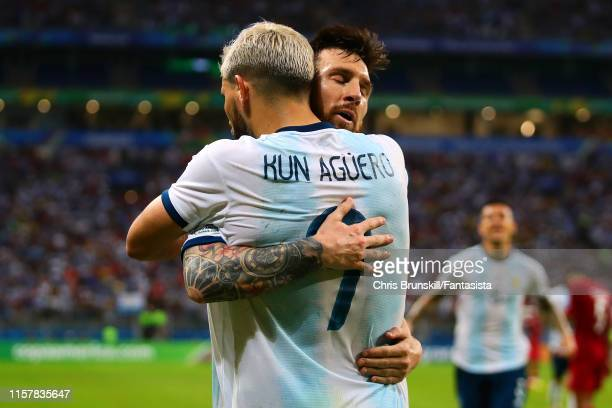 Sergio Aguero of Argentina is congratulated by team-mate Lionel Messi after scoring his side's second goal during the Copa America Brazil 2019 group...
