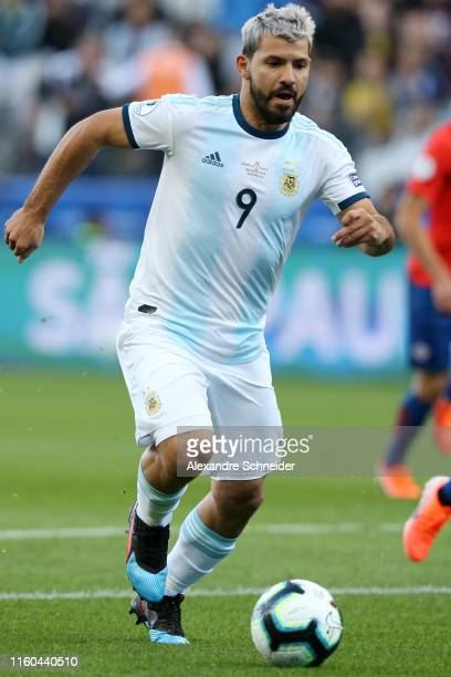 Sergio Aguero of Argentina runs with the ball to score the opening goal during the Copa America Brazil 2019 Third Place match between Argentina and...