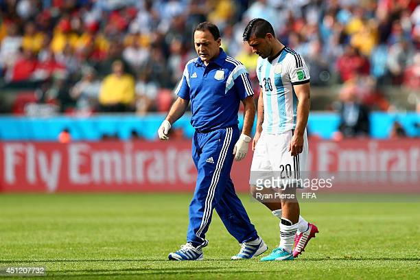 Sergio Aguero of Argentina walks off the pitch after being replaced as he picks up injury during the 2014 FIFA World Cup Brazil Group F match between...
