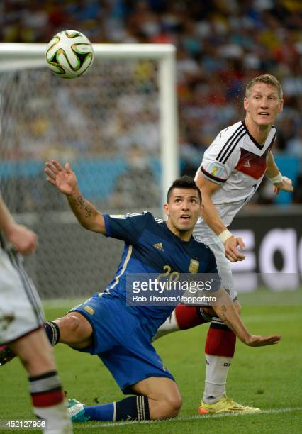 Sergio Aguero of Argentina with Bastian Schweinsteiger of Germany during the 2014 FIFA World Cup Brazil Final match between Germany and Argentina at...