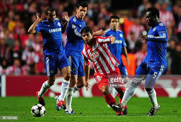 Sergio Aguero of Atletico Madrid battles for the ball with Michael Essien of Chelsea Ashley Cole of Chelsea and Michael Ballack of Chelsea during the...
