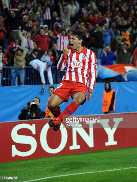 Sergio Aguero of Atletico Madrid celebrates after scoring his second goal against Chelsea during the UEFA Champions League Group D match on November...