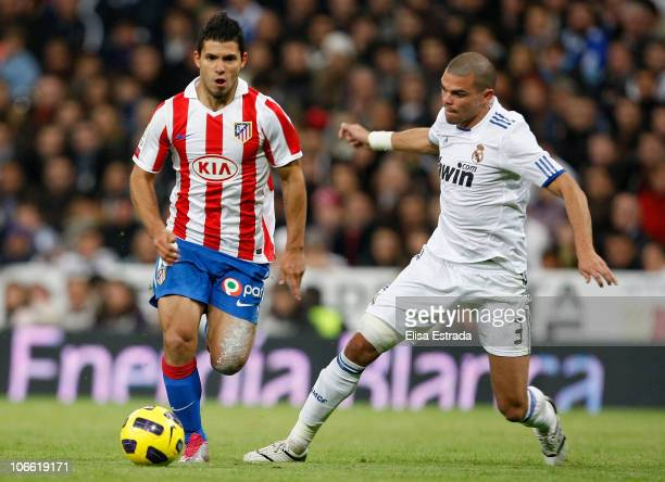 Sergio Aguero of Atletico Madrid is challenged by Pepe of Real Madrid during the La Liga match between Real Madrid and Atletico Madrid at Estadio...