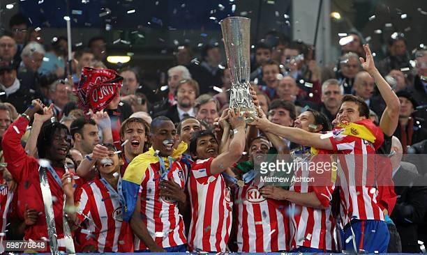 Sergio Aguero of Atletico Madrid lifts the UEFA Europa League Trophy