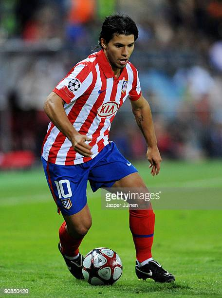 Sergio Aguero of Atletico Madrid runs with the ball during the Champions League group D match between Atletico Madrid and APOEL FC at the Vicente...