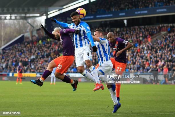 Sergio Aguero of Man City and Fernandinho of Man City battle for a header with Elias Kachunga of Huddersfield and Jonathan Hogg of Huddersfield...