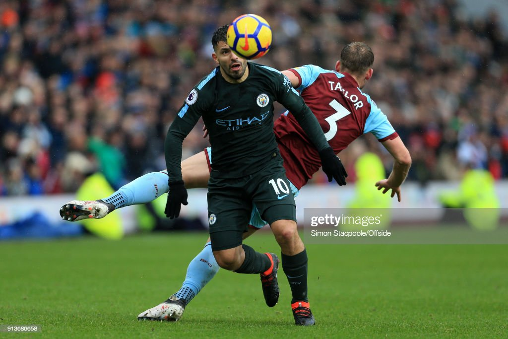 Sergio Aguero of Man City battles with Charlie Taylor of Burnley during the Premier League match between Burnley and Manchester City at Turf Moor on February 3, 2018 in Burnley, England.
