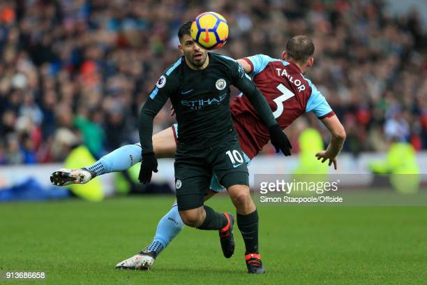 Sergio Aguero of Man City battles with Charlie Taylor of Burnley during the Premier League match between Burnley and Manchester City at Turf Moor on...