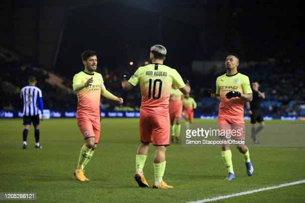 Sergio Aguero of Man City celebrates with teammates David Silva of Man City and Gabriel Jesus of Man City after scoring their 1st goal during the FA...
