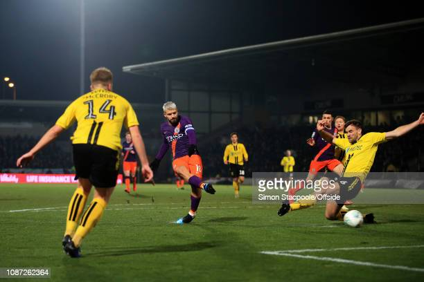 Sergio Aguero of Man City scores their 1st goal during the Carabao Cup Semi Final Second Leg match between Burton Albion and Manchester City at the...