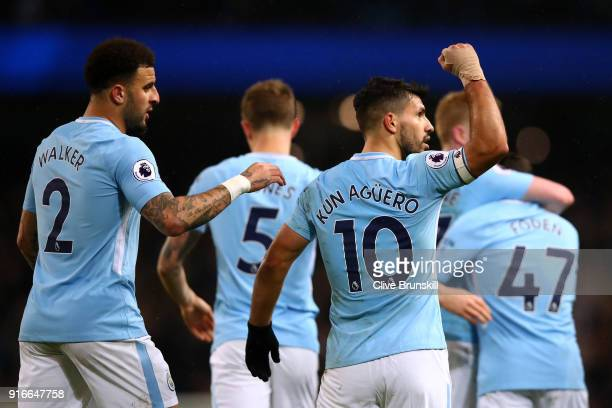 Sergio Aguero of Manchecster City celebrates scoring his fourth goal his side's fifth with team mates during the Premier League match between...