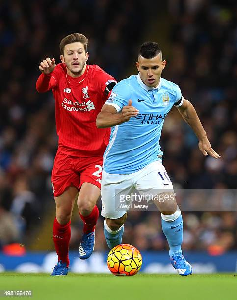 Sergio Aguero of Manchester City and Adam Lallana of Liverpool during the Barclays Premier League match between Manchester City and Liverpool at...