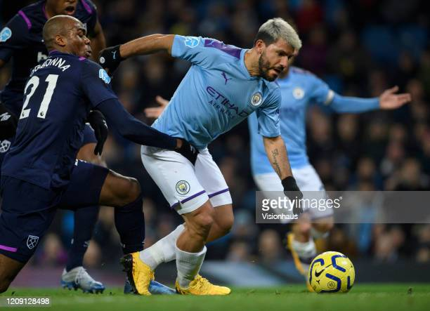 Sergio Aguero of Manchester City and Angelo Ogbonna of West Ham United in action during the Premier League match between Manchester City and West Ham...