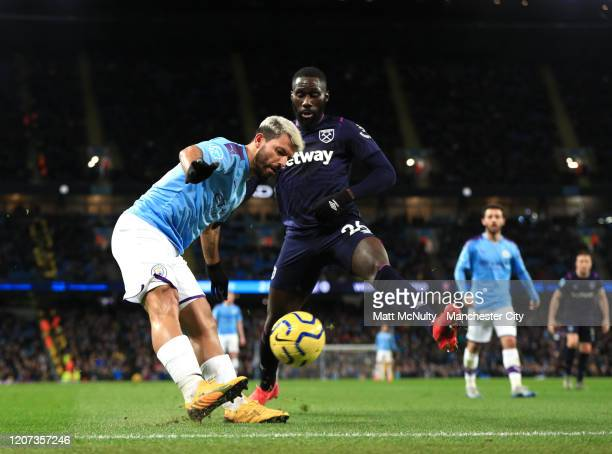 Sergio Aguero of Manchester City and Arthur Masuaku of West Ham United during the Premier League match between Manchester City and West Ham United at...