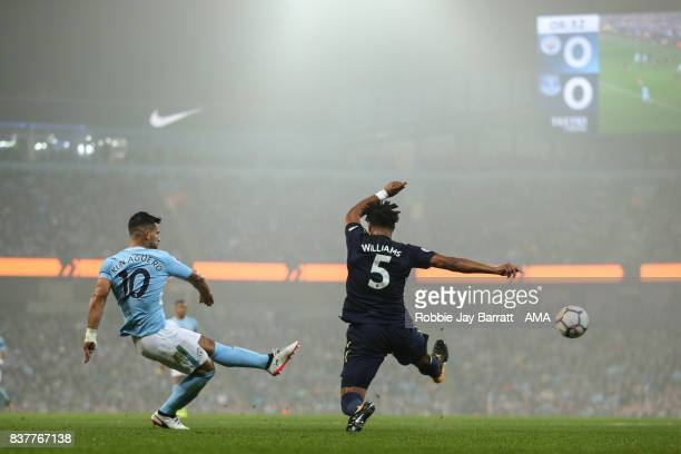 Sergio Aguero of Manchester City and Ashley Williams of Everton during the Premier League match between Manchester City and Everton at Etihad Stadium...