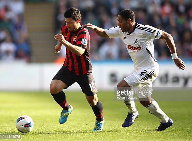 Sergio Aguero of Manchester City and Ashley Williams of Swansea City battle for the ball during the Barclays Premier League match between Swansea...