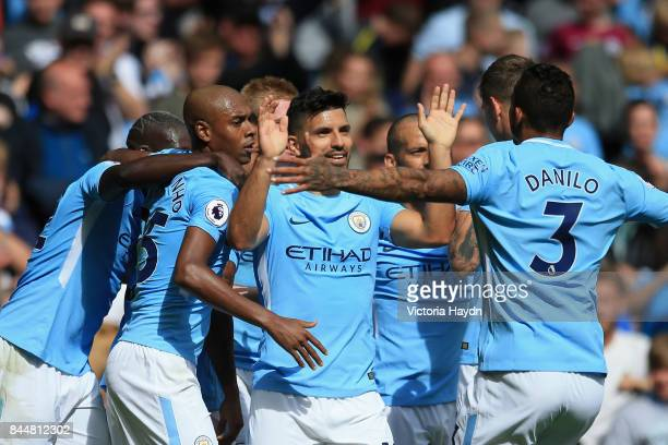 Sergio Aguero of Manchester City and Danilo of Manchester City celebrate their sides second goal during the Premier League match between Manchester...