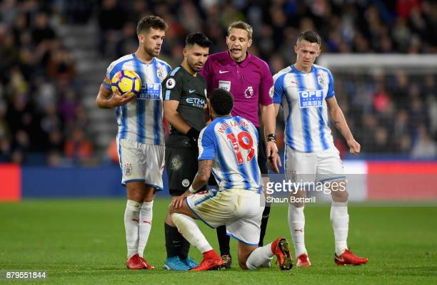 Sergio Aguero of Manchester City and Danny Williams of Huddersfield Town argue during the Premier League match between Huddersfield Town and...