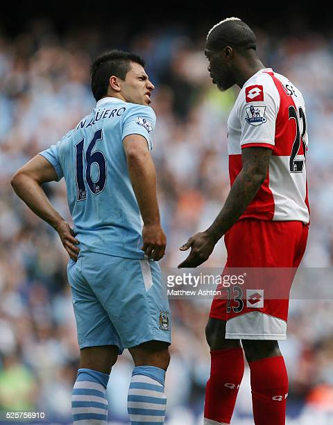 Sergio Aguero of Manchester City and Djibril Cisse of Queens Park Rangers