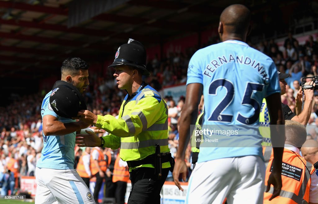 Sergio Aguero of Manchester City and Fernandinho of Manchester City argue with a police man during the Premier League match between AFC Bournemouth and Manchester City at Vitality Stadium on August 26, 2017 in Bournemouth, England.