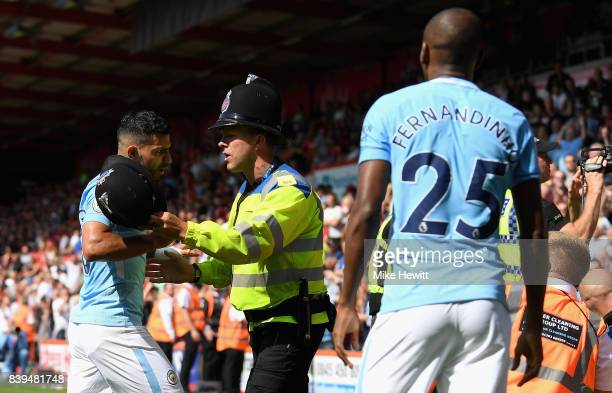 Sergio Aguero of Manchester City and Fernandinho of Manchester City argue with a police man during the Premier League match between AFC Bournemouth...