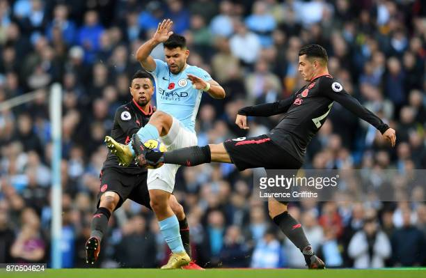 Sergio Aguero of Manchester City and Granit Xhaka of Arsenal battle for possession during the Premier League match between Manchester City and...