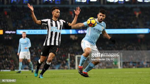 Sergio Aguero of Manchester City and Jacob Murphy of Newcastle United during the Premier League match between Manchester City and Newcastle United at...