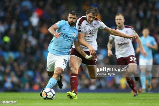Sergio Aguero of Manchester City and James Tarkowski of Burnley battle for possession during the Premier League match between Manchester City and...