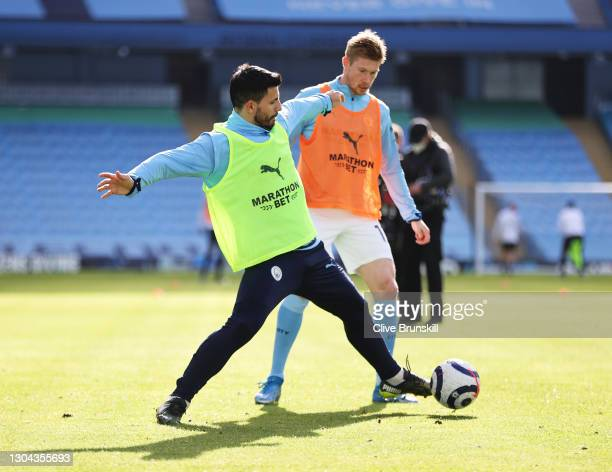 Sergio Aguero of Manchester City and Kevin De Bruyne of Manchester City warm up prior to the Premier League match between Manchester City and West...