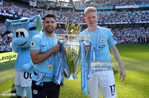Sergio Aguero of Manchester City and Kevin De Bruyne of Manchester City celebrate with The Premier League Trophy after the Premier League match...