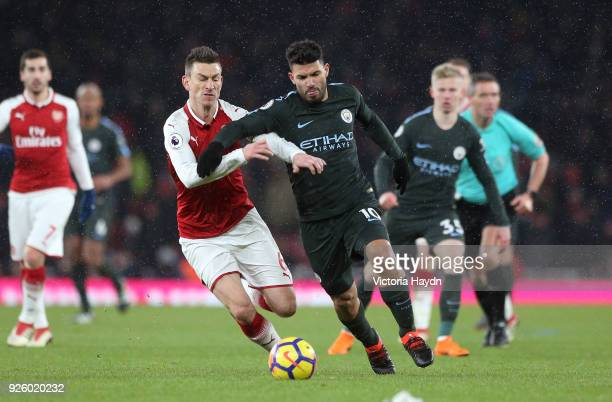 Sergio Aguero of Manchester City and Laurent Koscielny of Arsenal battle for possession during the Premier League match between Arsenal and...