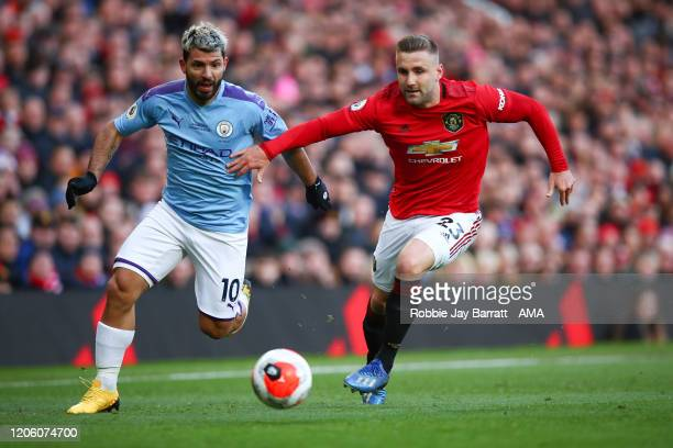 Sergio Aguero of Manchester City and Luke Shaw of Manchester United during the Premier League match between Manchester United and Manchester City at...