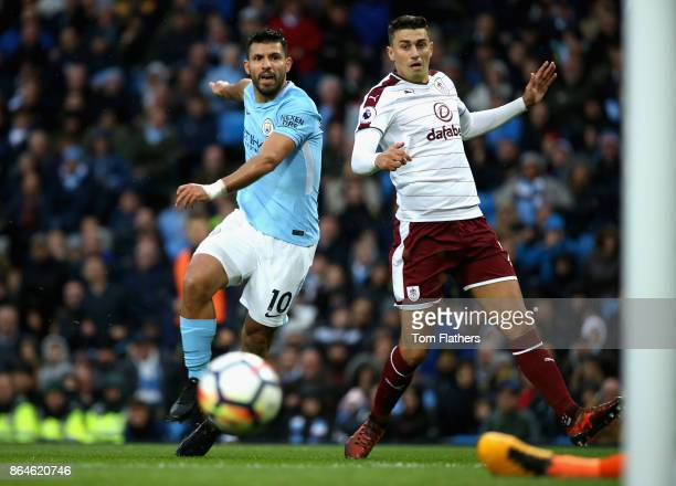 Sergio Aguero of Manchester City and Matthew Lowton of Burnley battle for the ball during the Premier League match between Manchester City and...