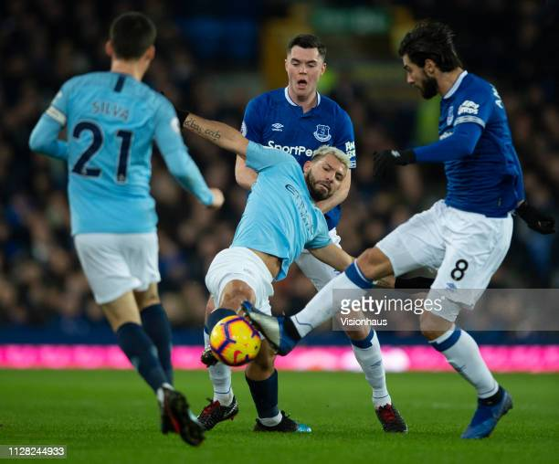 Sergio Aguero of Manchester City and Michael Keane and Andre Gomes of Everton in action during the Premier League match between Everton FC and...